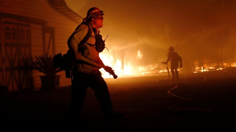 A firefighter gives orders as he battles the wind-driven Kincade Fire in Windsor, California, U.S. October 27, 2019
