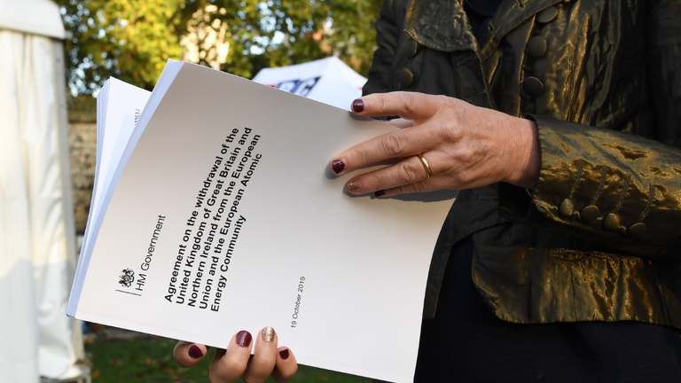 "MP Liz Saville-Roberts holds a copy of the Withdrawal Agreement outside the Houses of Parliament in London ahead of Prime Minister Boris Johnson delivering a statement in the House of Commons on his new Brexit deal after the EU Council summit, on what has been dubbed ""Super Saturday""."