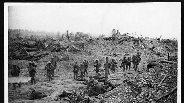 Soldiers stand among rubble in Wytschaete in June 1917