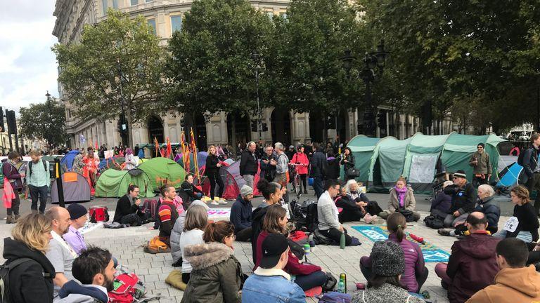 Protesters meditate in Trafalgar Square. Pic: Sanya Burgess