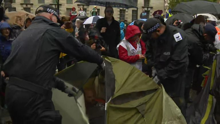 Sky News is on the ground as police move in to clear tents and arrest climate protesters outside Downing Street.