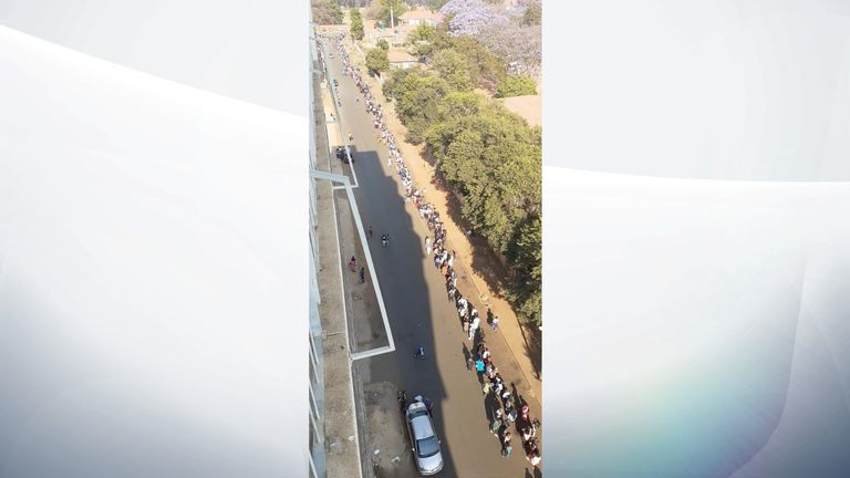 Queues for a passport in Zimbabwe