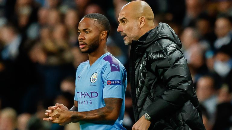 Pep Guardiola gives Raheem Sterling some instructions during Manchester City's 2-0 win over Dinamo Zagreb