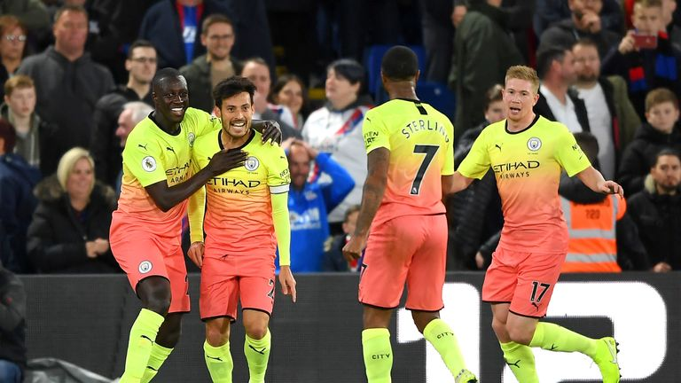 David Silva celebrates with his team-mates Benjamin Mendy, Kevin De Bruyne and Raheem Sterling