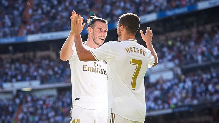 Eden Hazard celebrates with Gareth Bale after scoring for Real Madrid against Granada