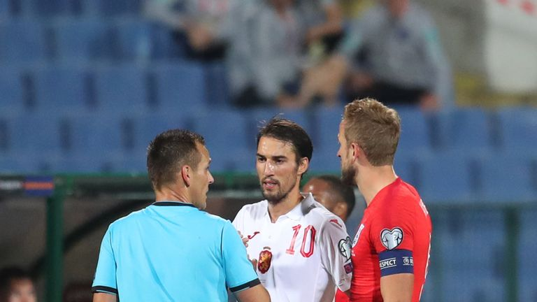 Team captains Ivelin Popov of Bulgaria and England's Harry Kane speak with referee Ivan Bebek during the UEFA Euro 2020 qualifier in Sofia