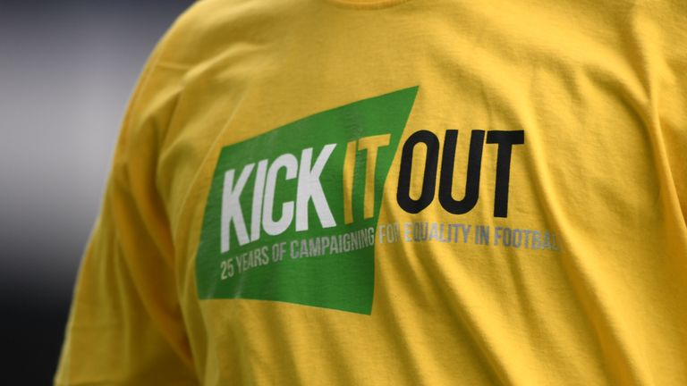 Detail of a 'Kick it Out' t-shirt worn by players in the Premier League