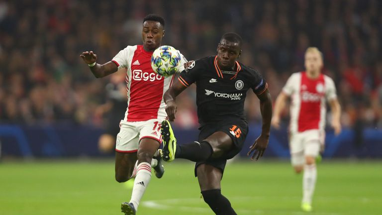 Kurt Zouma of Chelsea battles for possession with Quincy Promes of AFC Ajax during the UEFA Champions League group H match between AFC Ajax and Chelsea FC at Amsterdam Arena on October 23, 2019 in Amsterdam, Netherlands