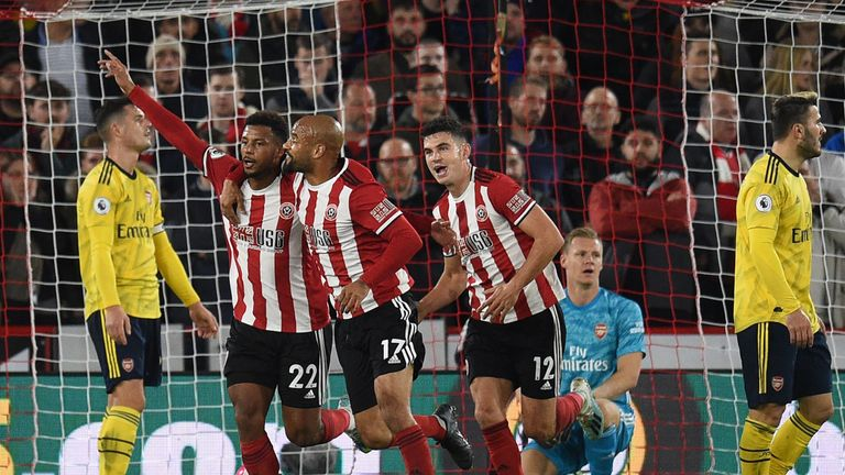 Sheffield United's French striker Lys Mousset (2nd L) celebrates with teammates after scoring the opening goal past during the English Premier League football match between Sheffield United and Arsenal at Bramall Lane in Sheffield, northern England on October 21, 2019.