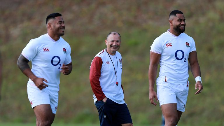 Eddie Jones watches on as Manu Tuilagi takes part in England training