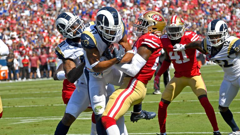 LOS ANGELES, CA - OCTOBER 13: Wide receiver Robert Woods #17 of the Los Angeles Rams gets into the end zone for a touchdown past cornerback Jimmie Ward #20 of the San Francisco 49ers with some help from tight end Gerald Everett #81 of the Los Angeles Rams in the first quarter of the game at the Los Angeles Memorial Coliseum on October 13, 2019 in Los Angeles, California. (Photo by Jayne Kamin-Oncea/Getty Images)