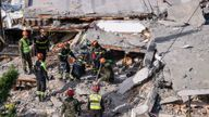 Italian search and rescue workers look for survivors in Durres, western Albania