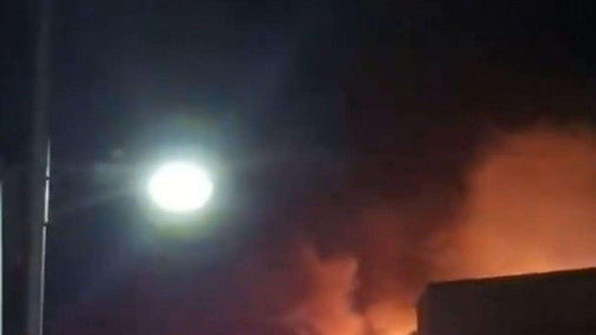 40 fire crews tackling flames 'crawling up cladding' at student flats