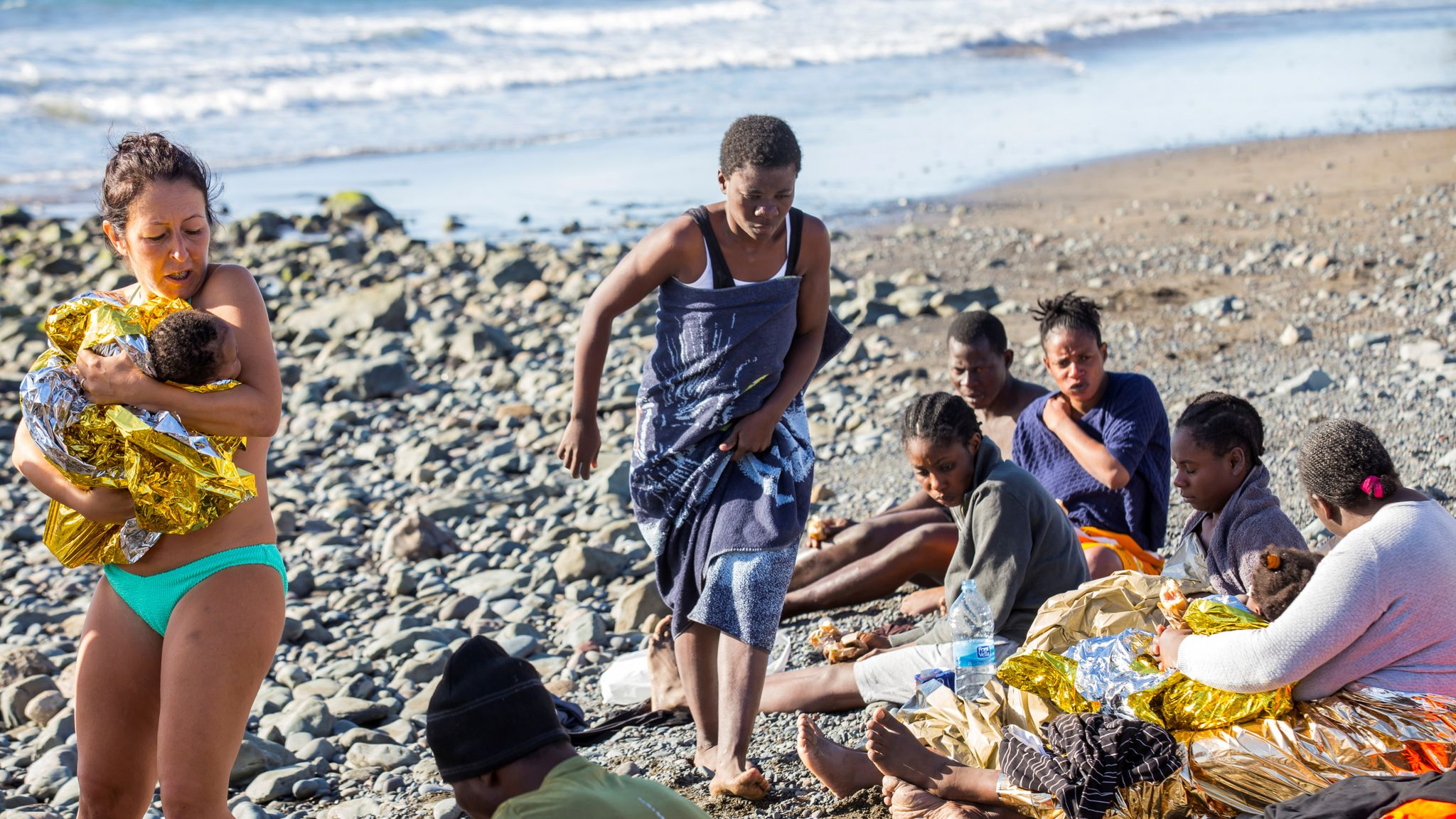 Sunbathers help save migrants washed up on Gran Canaria beach