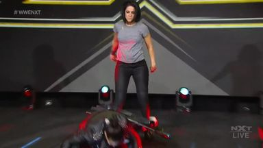 Bayley assaults Baszler with a chair