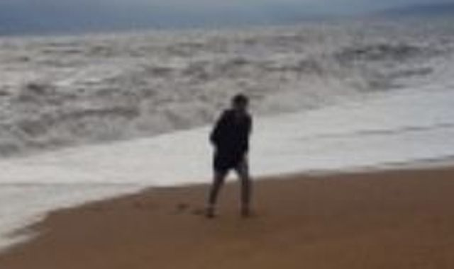 Photo of 'hero' son taken moments before he was swept out to sea while saving mum's life