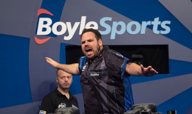 Grand Slam of Darts: Adrian Lewis reaches last 16 with victory over Jim Williams