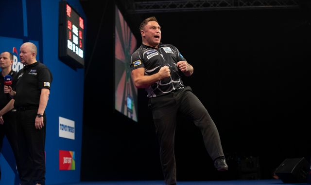 Grand Slam of Darts: Gerwyn Price beats Peter Wright to retain title
