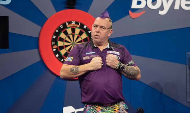 Grand Slam of Darts: Peter Wright books semi-final place by beating Dave Chisnall