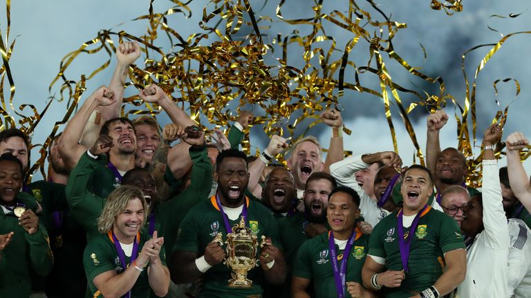 YOKOHAMA, JAPAN - NOVEMBER 02: South Africa captain Siya Kolisi celebrates with teammates following his victory during the 2019 Rugby World Cup final between England and South Africa at Yokohama International Stadium on 2 November 2019 in Yokohama, Kanagawa, Japan. (Photo by David Rogers / Getty Images)