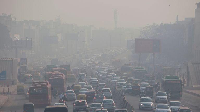 Indian commuters drive amidst heavy smog along a busy road past the South Extension area of New Delhi on December 6, 2018. - Smog levels spike during winter in Delhi, when air quality often eclipses the World Health Organization's safe levels. Cooler air traps pollutants -- such as from vehicles, building sites and farmers burning crops in regions outside the Indian capital -- close to the ground. (Photo by XAVIER GALIANA / AFP)        (Photo credit should read XAVIER GALIANA/AFP via Getty Images)