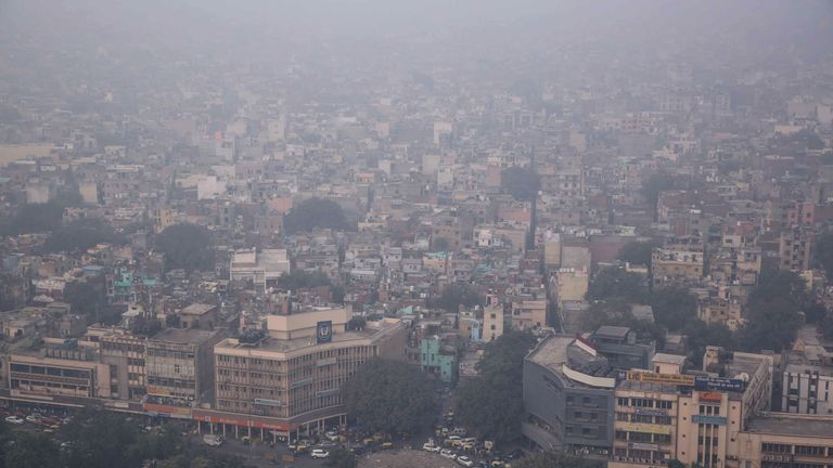 This aerial photograph shows heavy pollution smog covering the capital city of Delhi on November 1, 2019. (Photo by STR / AFP) (Photo by STR/AFP via Getty Images)