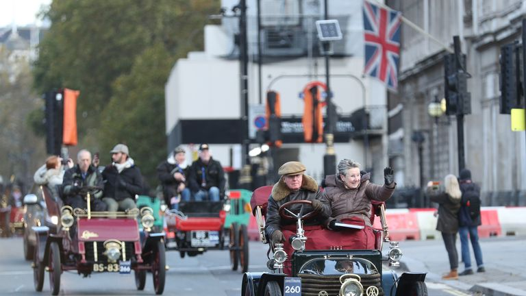 Participants driving their vehicles past the Houses of Parliament, London, during the Bonhams London to Brighton Veteran Car Run.