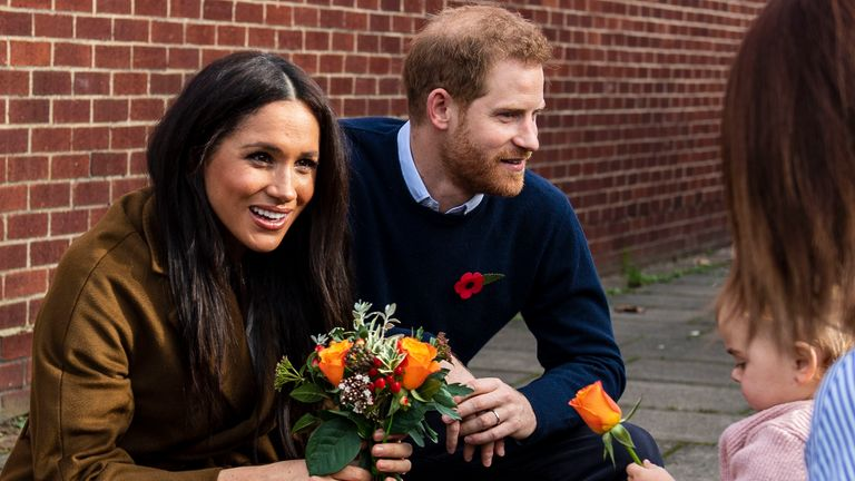 Handout photo dated 06/11/19 issued by MoD showing the Duchess of Sussex receiving a posy of flowers from Bonnie and Maggie Emanuel (mother and daughter), during a visit to Broom Farm Community Centre in Windsor. The Duke and Duchess of Sussex attended a coffee morning with families of deployed Army personnel at the Centre.