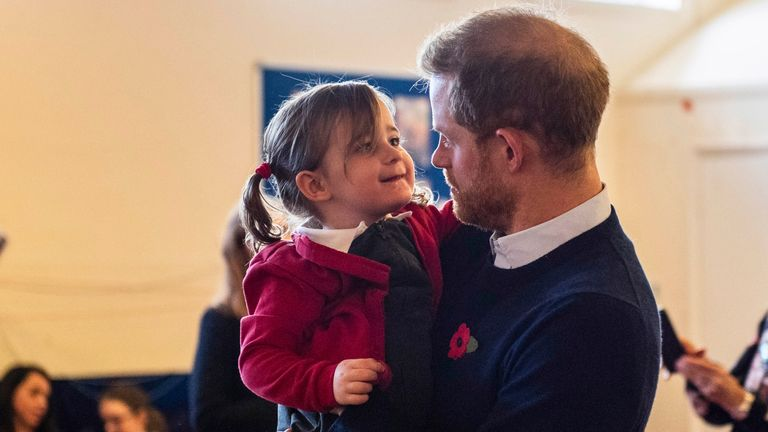 Handout photo dated 06/11/19 issued by MoD showing Poppy Dean being held by the Duke of Sussex, during a visit to Broom Farm Community Centre in Windsor. The Duke and Duchess of Sussex attended a coffee morning with families of deployed Army personnel at the Centre.