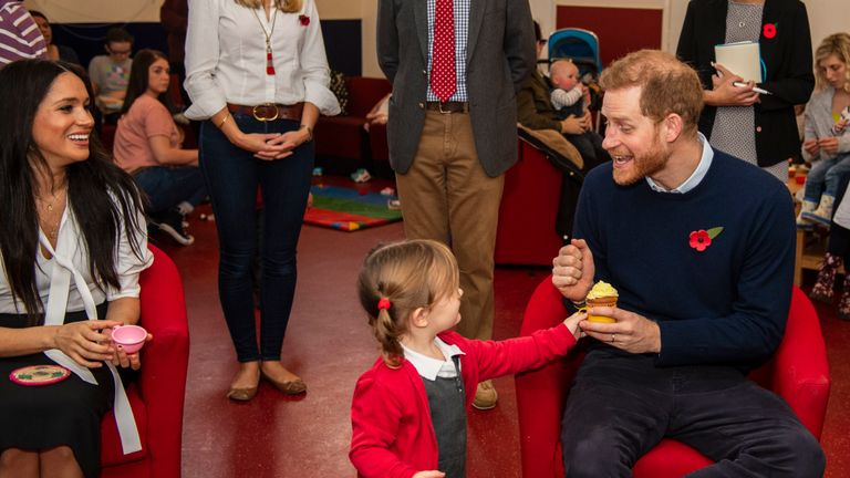 Handout photo dated 06/11/19 issued by MoD showing Poppy Dean giving a cake to The Duke of Sussex, during a visit to Broom Farm Community Centre in Windsor. The Duke and Duchess of Sussex attended a coffee morning with families of deployed Army personnel at the Centre.