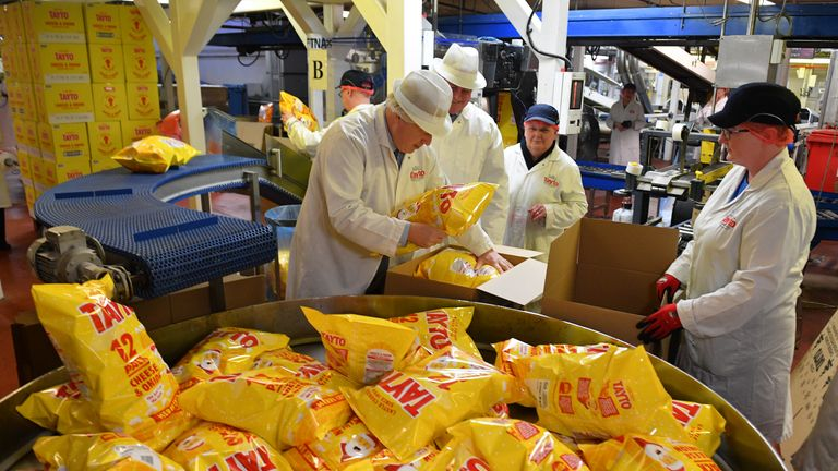 ARMAGH, NORTHERN IRELAND - NOVEMBER 07: Prime Minister Boris Johnson helps to pack crisps during a general election campaign visit to the Tayto Castle crisp factory on November 07, 2019 in County Armagh, Northern Ireland, United Kingdom. (Photo by Daniel Leal-Olivas - WPA Pool/Getty Images)