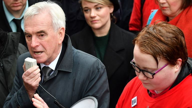 "Britain's main opposition Labour Party shadow Chancellor of the Exchequer John McDonnell (L) speaks during a 'McStrike' demonstration in support of striking McDonald's workers, outside the entrance to 10 Downing Street in central London on November 12, 2019. - Workers calling for higher pay and better treatment took part in a global ""McStrike"", with fast food employees demonstrating around the world. (Photo by Ben STANSALL / AFP) (Photo by BEN STANSALL/AFP via Getty Images)"