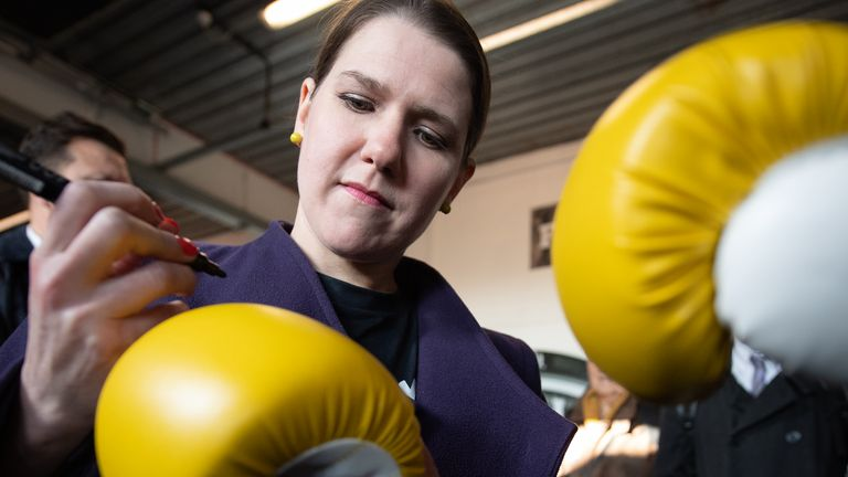 LONDON, ENGLAND - NOVEMBER 13: Jo Swinson, Leader of the Liberal Democrats signs a boxing glove as she campaigns at a boxing gym for young people on November 13, 2019 in London, England. The United Kingdom will hold a general election on December 12.  (Photo by Leon Neal/Getty Images)