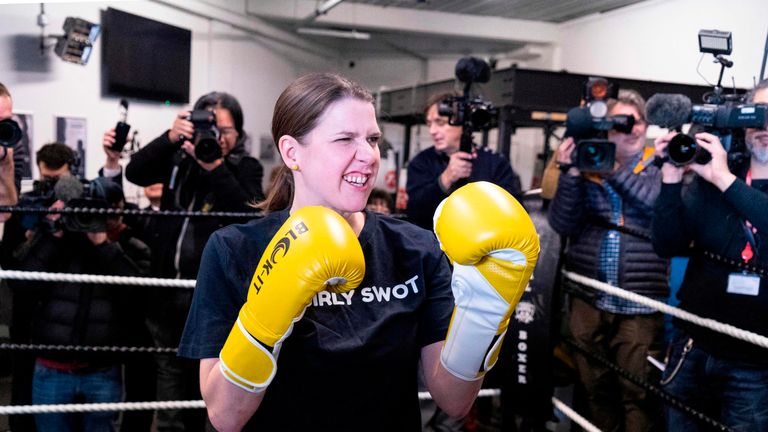 Britian's Liberal Democrats leader Jo Swinson poses as she takes a boxing lesson at Total Boxer, a boxing gym offering training to young people as a means of keeping them away from violence, campaigning for the general election in northeast London on November 13, 2019. - Britain goes to the polls on December 12 to vote in a pre-Christmas general election. (Photo by Niklas HALLE'N / AFP) (Photo by NIKLAS HALLE'N/AFP via Getty Images)