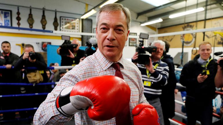 Brexit party leader Nigel Faraj wears boxing gloves at a general election campaign event at the Balsever Boxing Club in Chesterfield, UK, November 5, 2019. REUTERS / Phil Noble TPKS NAMES OF THE DAY