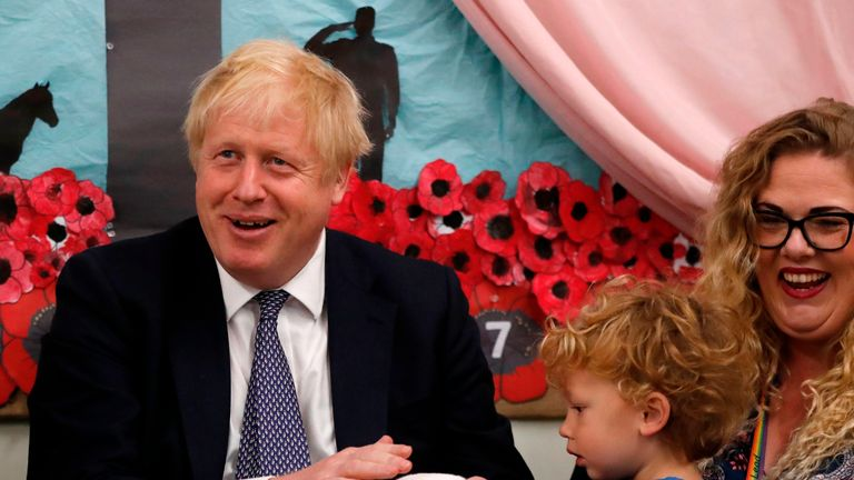 Britain's Prime Minister Boris Johnson holds Rosie the rabbit during a visit to a primary school while on the campaign trail in Taunton, southwest England on November 14, 2019. (Photo by Frank Augstein / POOL / AFP) (Photo by FRANK AUGSTEIN/POOL/AFP via Getty Images)
