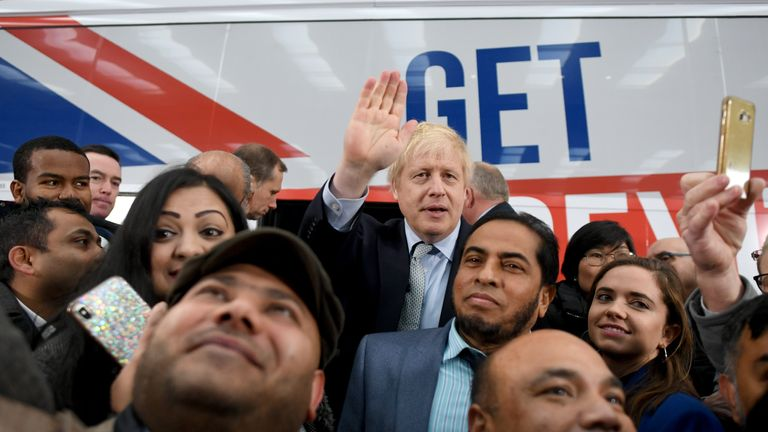 Prime Minister Boris Johnson is surrounded by supporters at the unveiling of the Conservative Party battlebus in Middleton, Greater Manchester.