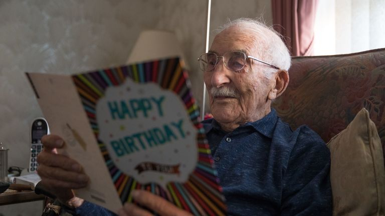 John Jenkins reads a birthday card from the Hampshire and Isle of Wight Air Ambulance charity in his home, in Portsmouth, ahead of his 100th birthday. The D-Day veteran, who took part in a secret reconnaissance mission to check out the Normandy beaches for the Allied forces ahead of the June 1944 landings, is celebrating his 100th birthday.