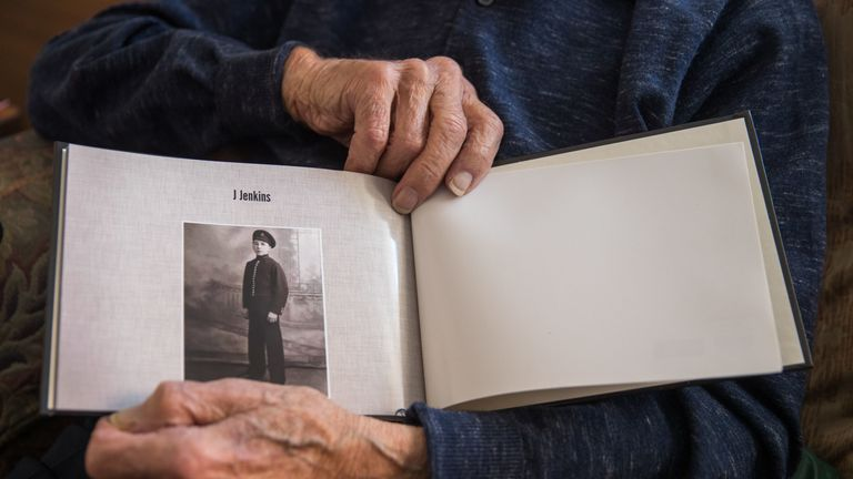 John Jenkins holds a photograph of himself on his first day as a bell boy for Cunard, in Portsmouth, ahead of his 100th birthday. The D-Day veteran, who took part in a secret reconnaissance mission to check out the Normandy beaches for the Allied forces ahead of the June 1944 landings, is celebrating his 100th birthday.