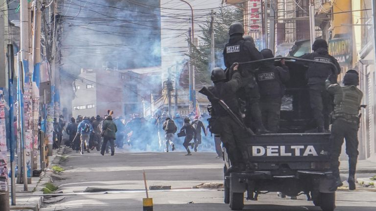 LA PAZ, BOLIVIA - NOVEMBER 15: Miners from Colquiri receive tear gas from police during a protest on November 15, 2019 in La Paz, Bolivia. Morales flew to Mexico alleging a coup under military pressure following three weeks of protests due to suspects and claims of fraud in the presidential elections. Newly self-declared interim president Jeanine Añez faces challenges to her leadership in the senate and in the streets. (Photo by Javier Mamani/Getty Images)