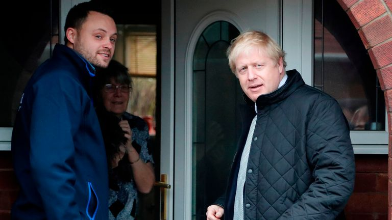 Britain's Prime Minister Boris Johnson (R) canvasses with Conservative party candidate for the Mansfield constituency, Ben Bradley on the General Election campaign trail in Mansfield, Nottinghamshire on November 16, 2019. - Britain goes to the polls on December 12, 2019. (Photo by Frank Augstein / POOL / AFP) (Photo by FRANK AUGSTEIN/POOL/AFP via Getty Images)