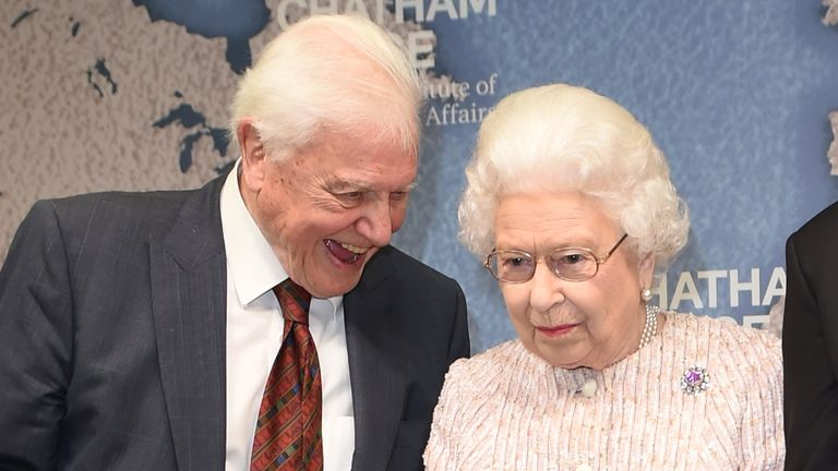 Queen Elizabeth II alongside Sir David Attenborough after she presented both him and Julian Hector, Head of the BBC Natural History Unit, the 2019 Chatham House Prize at the Royal institute of International Affairs, Chatham House, London.