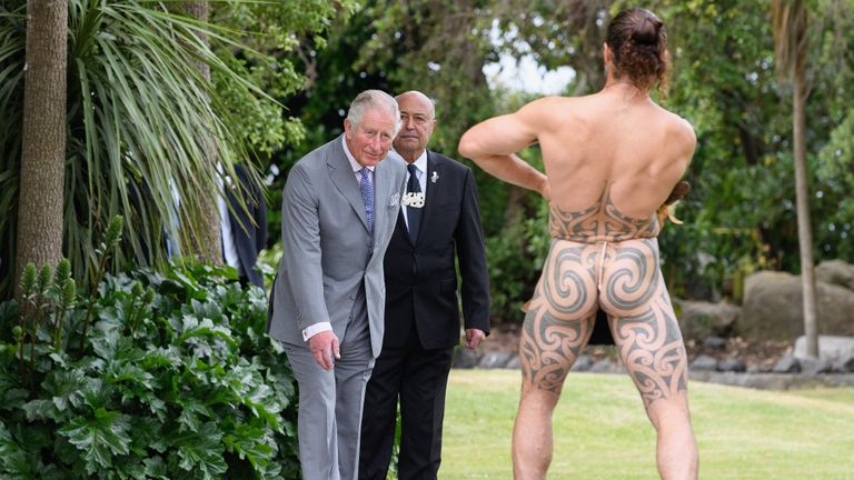 KAIKOURA, NEW ZEALAND - NOVEMBER 23: A Maori warrior welcomes Prince Charles, Prince of Wales during a traditional welcome ceremony at Takahanga Marae on November 23, 2019 in Kaikoura, New Zealand. The Prince of Wales and Duchess of Cornwall are on an 8-day tour of New Zealand. It is their third joint visit to New Zealand and first in four years. (Photo by Kai Schwoerer/Getty Images)