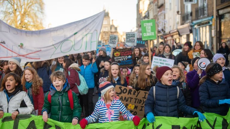 Children take part in the YouthStrike4Climate march in Cambridge.