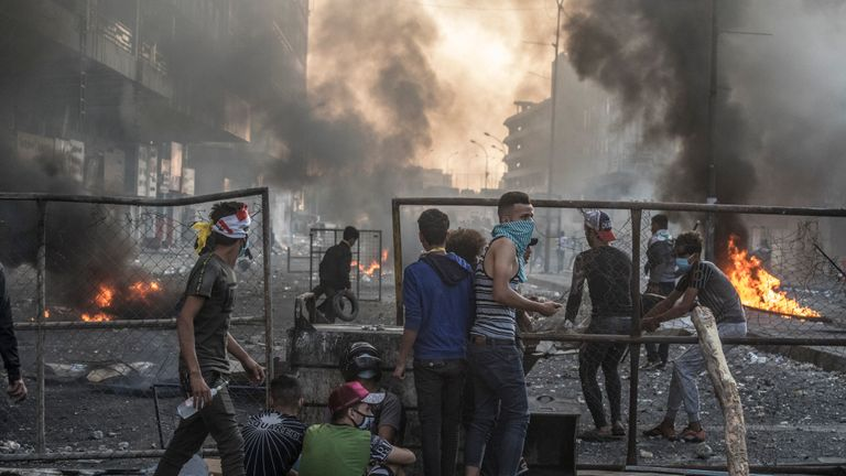 BAGHDAD, IRAQ - NOVEMBER 11, 2019:   Iraqi security forces try to push back anti-government demonstrators to Tahrir Square (Liberation Square) and the Al-Jumuriyah, firing tear or even sometime real bullets to prevent protesters occupied again other bridges  in downtown Baghdad  More than 300 protesters have been killed during the unrest, which started October 1. (Photo by Laurent Van der Stockt for Le Monde/Getty Images)