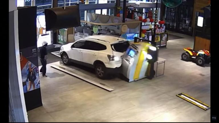 Two men were caught on camera unsuccessfully attempting to steal an ATM from a Melbourne shopping centre.
