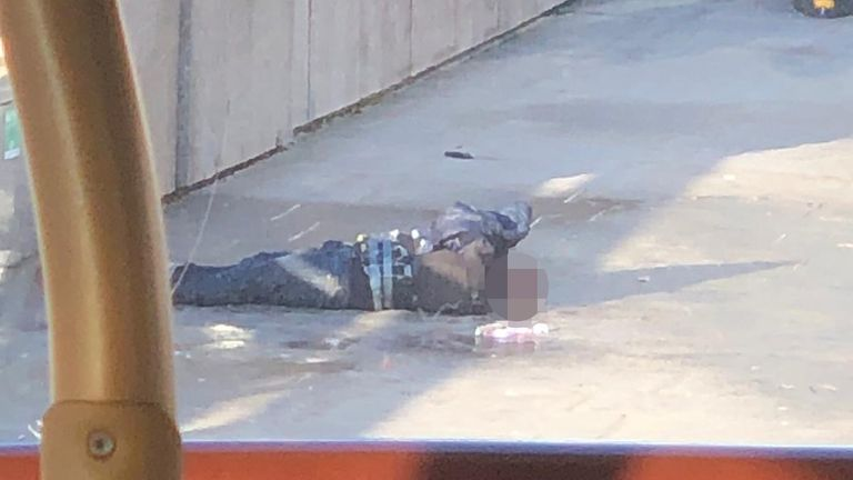 This picture of the alleged attacker appears to show the hoax explosive device