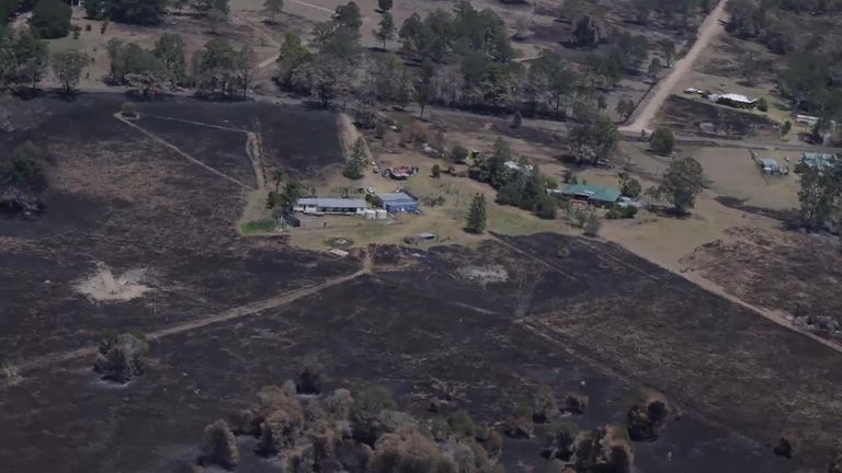 Huge areas of scorched earth pockmark the ground in New South Wales