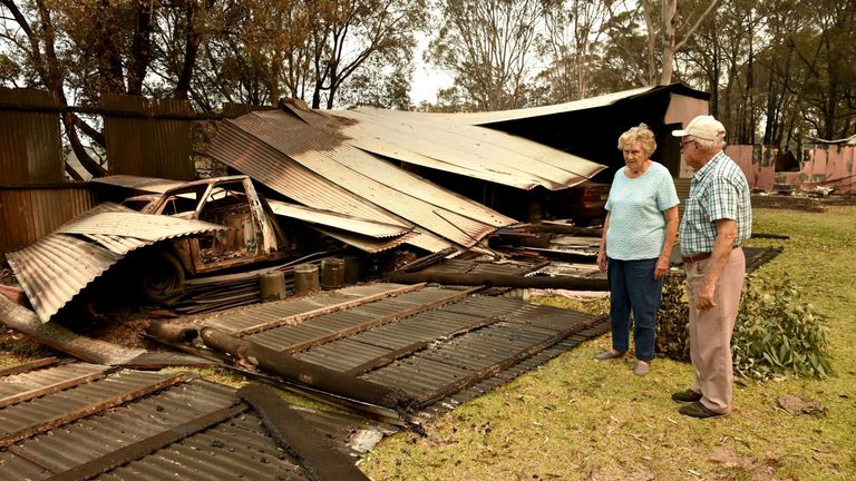 Art Murphy (R) and his wife Shirley have seen parts of their property in Old Bar, 350km north of Sydney,  destroyed