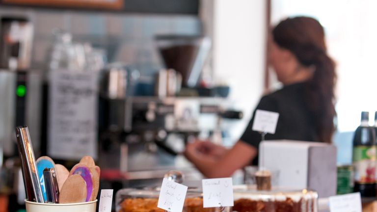 Barista making coffee in an independent coffee shop